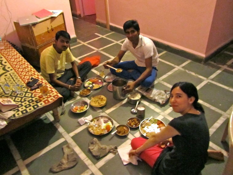 The old caretaker, the new caretaker and me having dinner at the house in India.