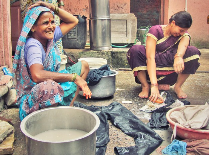 Cheerful women doing laundry in India