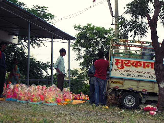 Loading the ready Ganesh statues into the truck.