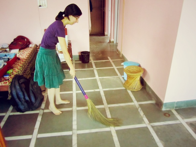 Me sweeping our India house with an Indian broom.