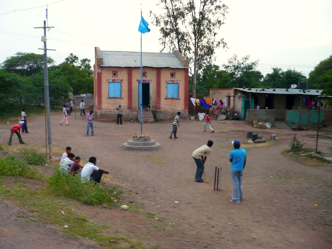 Playing cricket. A very important thing in India.