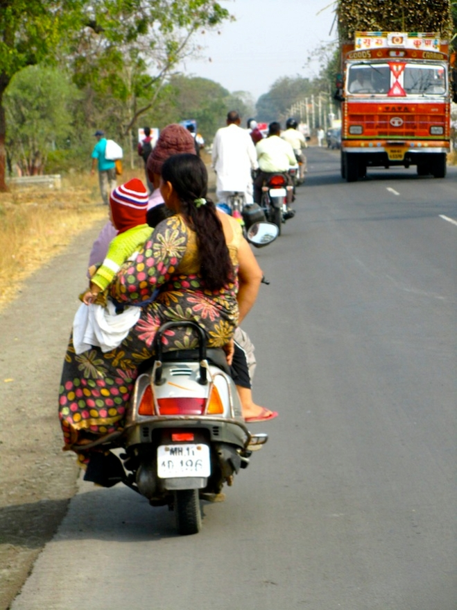 Families riding motorcycles is a common sight.