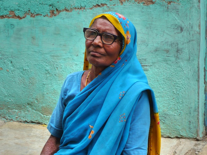 A woman wearing a blue sari in India.